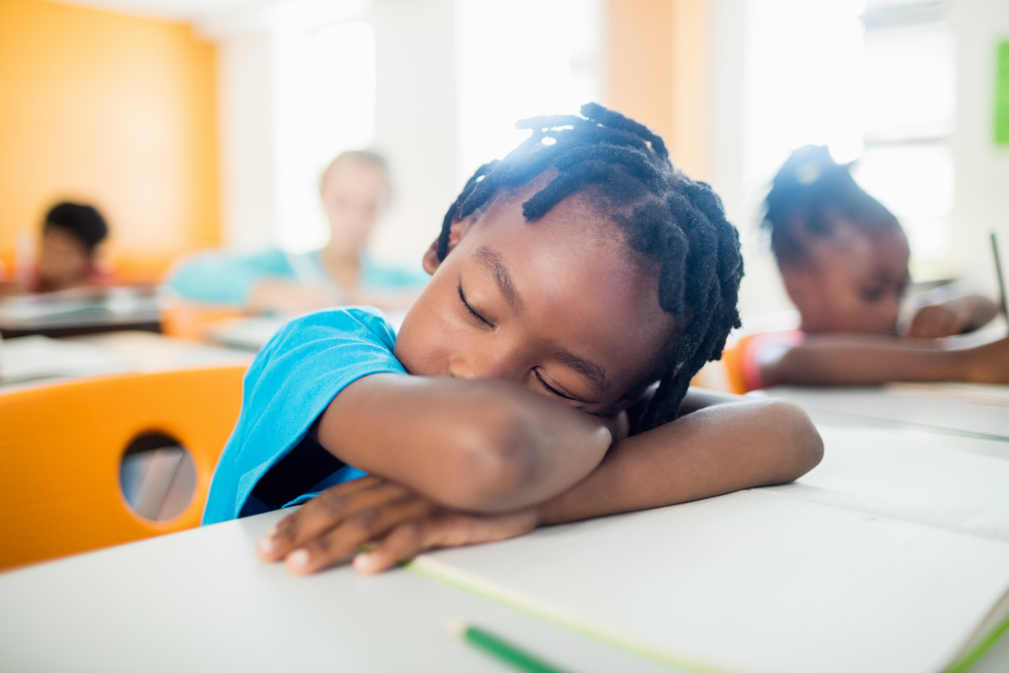 Pupil,Falling,Asleep,At,His,Desk,In,Classroom