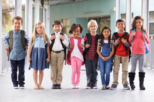 Group,Of,Elementary,School,Kids,Standing,In,School,Corridor